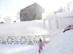 Children play around a snow sculpture prior to the opening of the 60th Sapporo snow festival in Sapporo, Japan. 60th Sapporo snow festival