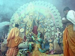 Priest performs rituals in front of an idol of Goddess Durga during the Durga Puja in New Delhi. Puja fever at peak