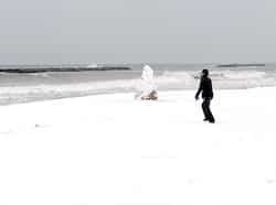 A man walks on the snow covered beach of Palavas-les-Flots after heavy snow falls on the south of France. March 2010: Indians Abroad