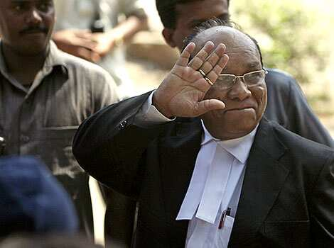 Defense lawyer KP Pawar waves as he arrives at the the special court set up for the trial of a Pakistani accused of being the sole surviving gunman in the 2008 terror attacks in Mumbai. The day Kasab got death