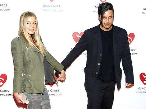 Carmen Electra and Rob Patterson arrive at the sixth annual MusiCares MAP Fund benefit concert to celebrate Women In Recovery, held in honor of former first lady Betty Ford and the Betty Ford Center at Club Nokia in Los Angeles. Musicares MAP Fund concert