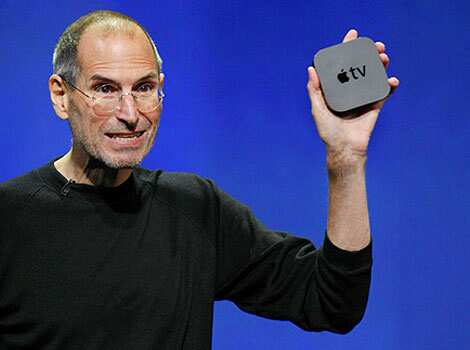 Apple CEO Steve Jobs displays the new Apple TV at the news conference in San Francisco. It also unveiled a new line of iPods, including a touch-screen Nano model. Apple TV relaunch