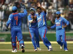Vinay Kumar celebrates with teammates after dismissing England