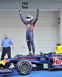 Red Bull-Renault driver Sebastian Vettel of Germany celebrates on the top of his car after finishing third and clinching the world championship at the Formula One Japanese Grand Prix at Suzuka. Unbeatable Vettel!