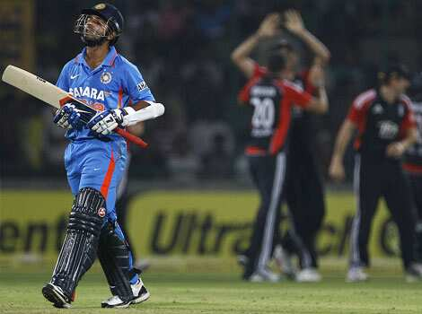 Ajinkya Rahane reacts as he leaves the ground after losing his wicket during their second one-day international cricket match against England in New Delhi. 2nd ODI: India beat England