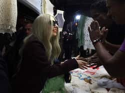 Lady Gaga (L) greets shopkeepers at the Dilli Haat handicrafts market in New Delhi. (AP) Lady Gaga came, saw and conquered