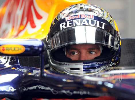 Red Bull-Renault driver Sebastian Vettel of Germany gets ready during the first practice session of Formula One