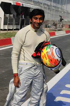 HRT-Cosworth driver Narain Karthikeyan smiles during the 3rd practice session of Indian Grand Prix at the Buddh International Circuit in Greater Noida, Uttar Pradesh. (HT Photo by Virendra Singh Gosain) Who will win Indian GP?