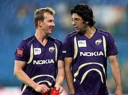 Kolkata Knight riders bowling coach Wasim Akram with bowler Brett Lee chat before the starting of the match against Warriors during the Champions League T20-2011 in Bangalore. KKR beat Warriors
