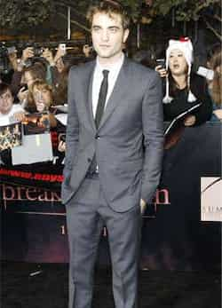 Robert Pattinson, the lovable vampire, poses at the premiere of The Twilight Saga: Breaking Dawn - Part 1. (Reuters/Mario Anzuoni) PREMIERE! The Twilight Saga: Breaking Dawn