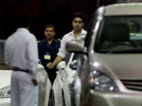 Father of the baby Abhishek Bachchan stands outside the hospital where his wife Aishwarya Rai Bachchan gave birth to a baby girl on Wednesday. SPOTTED: Bachchans with Beti B