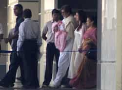 "Amitabh Bachchan holds his granddaughter while walking out of the hospital with daughter-in-law Aishwarya. Big B tweeted: ""THE"