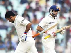 Indian captain Mahendra Singh Dhoni (L) and VVS Laxman complete a run during the second day of the second Test match between Indian and West Indies at the Eden Gardens in Kolkata. Eden Test, Day 2