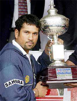 Sachin Tendulkar poses with the Man of the Series trophy after the final Test match between India and England in Bangalore 23 December 2001. The Test match was called off when play could not be resumed for the day due to bad weather conditions. India won the three Test match series by 1-0 with their win in the first Test in Mohali. AFP PHOTO Sachin Tendulkar, MP