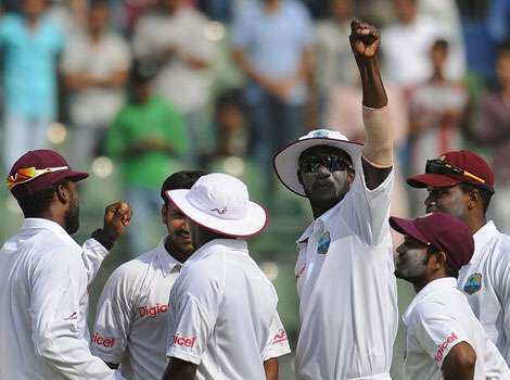 West Indies captain Darren Sammy (3rd R) gestures as he celebrates with team mates after the dismissal of Sachin Tendulkar during fourth day