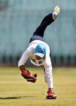 Wicketkeeper Parthiv Patel dives to catch a ball during a training session ahead of their fifth ODI cricket match against West Indies in Chennai. AP Photo/Aijaz Rahi Gearing up for the finals