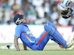 Manoj Tiwary sits on the ground due to cramps during the final ODI cricket match between India and West Indies in Chennai. India beat WI, clinch series