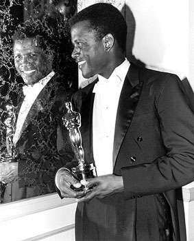 A touching moment as actor Sidney Poitier became the first ever African-American to win the award for the Best Actor for Lilies of the Field. Most Memorable Oscar Moments