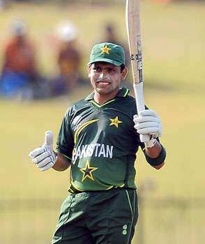 Pakistan batsman Kamran Akmal raises his bat to the crowd after scoring a half-century during the Group A match between Pakistan and Kenya in the World Cup Cricket tournament at The Suriyawewa Mahinda Rajapakse International Cricket Stadium in Hambantota. Pakistan thrash Kenya