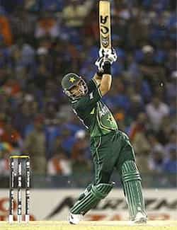 Misbah-ul-Haq lifts his bat for a six during the Cricket World Cup semifinal match between Pakistan and India in Mohali. India beat Pak to enter WC final