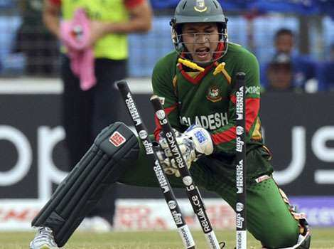 Bangladesh wicketkeeper Mushfiqur Rahim attempts to run out England batsman Jonathan Trott during the ICC Cricket World Cup 2011 match between England and Bangladesh at the Zahur Ahmed Chowdhury Stadium in Chittagong. England vs Bangladesh