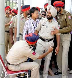 Police personnel frisks another before entering the PCA Stadium where India and Pakistan play semi-final match of ICC World Cup 2011, at Mohali. From Ground Zero