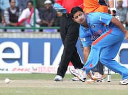 Piyush Chawla try to field the ball hit by the Netherlands Batsman Wesley Barresi during their ICC World Cup Match at Ferozshah Kotla stadium in  New Delhi. India v Netherlands