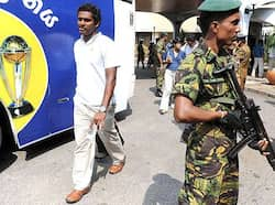 A Sri Lanka Special Task Force soldier stands guard while cricketer Angelo Mathews arrival at the international airport in Katunayake. Runners up reach home