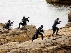 Navy SEALs practise Over The Beach evolutions during a training exercise. Navy SEALs are maritime special operations forces that strike from the sea, air and land and have the ability to conduct a variety of high-risk missions. These secretive specialists led the bold commando operation in Pakistan that took down the world