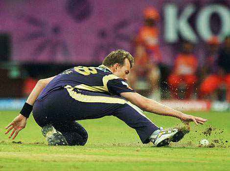 Kolkata Knight Riders bowler Brett Lee of Australia dives for the ball during the IPL Twenty20 cricket match between Kochi Tuskers Kerala and Kolkata Knight Riders at The Jawaharlal Nehru International Stadium in Kochi. Tuskers beat Riders