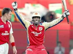 Chris Gayel of Royal Challengers Bangalore celebrates after scoring a century against Kings XI Punjab during IPL match in Bangalore. Gayle magic works for RCB