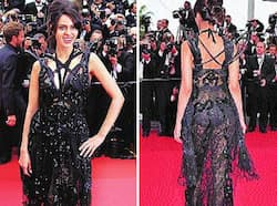 Mallika Sherawat arrived at the Cannes Film Festival in a see-through black dress flashing her panty. Butt show at Cannes 2011