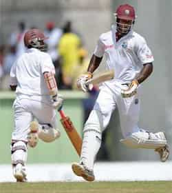 West Indies cricketers Kirk Edwards and Shivnarine Chanderpaul take a run during the fourth day of their third and final Test match against India at the Windsor Park Stadium in Roseau, Dominica. Ind vs WI: 3rd Test, Day 4