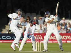VVS Laxman (R) plays a shot as England