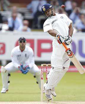 Suresh Raina (R) avoids a ball bowled by England