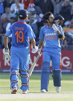 Virat Kohli (R) celebrates with batting partner Rahul Dravid after scoring a century in their One Day International cricket match against England, at Sophia Gardens cricket ground in Cardiff, Wales. India end Eng tour without a win