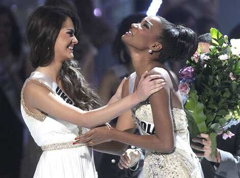 First runner up Miss Ukraine Olesia Stefanko congratulates Miss Angola Leila Lopes after she was named Miss Universe 2011. Miss Angola wins Miss Universe 2011