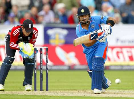 Virat Kohli, right, plays a shot as England wicketkeeper Craig Kieswetter looks on during the first one day international cricket match at the Riverside Cricket Ground in Durham, England. ODI washed out!