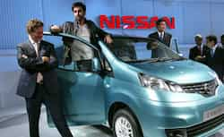Ranbir Kapoor gestures during the unveiling of Nissan Motor Co