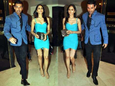 John Abraham was spotted with his rumoured girlfriend Priya at the Standard Chartered Marathon Bash hosted by Kingfisher. While John looks handsome in his blue-black attire, the investment banker outshines him in her short blue one-piece. LOVESTRUCK! John Abraham with Priya