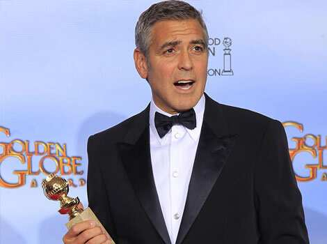 George Clooney, winner of best actor in a motion picture drama for his role in The Descendants, poses in the photo room at the 69th annual Golden Globe Awards in Beverly Hills, California. Reuters Winners of the Globe