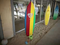 Surfboards for use by employees are lined up at the Google campus near Venice Beach, in Los Angeles, California. The 100,000 square-foot campus was designed by architect Frank Gehry, and includes an entrance through an iconic pair of giant binoculars designed by Claes Oldenburg and Coosje van Bruggen. (Reuters/Lucy Nicholson) Google