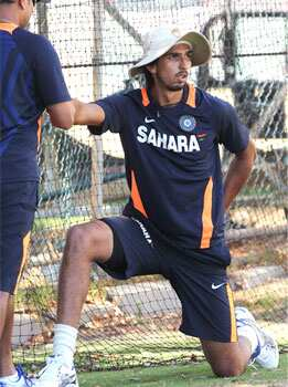 Ishant Sharma (R) stretches with a fitness coach during a practice session ahead of the third cricket test match against Australia in Perth. (AFP Photo) Face saver?