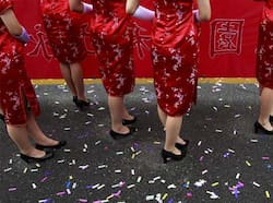Presenters in traditional Chinese Chi Pao dresses wait on the sideline during National Day celebrations marking the 101st anniversary of the founding of the Republic of China in front of the Presidential Office in Taipei. AP Photo/Wally Santana Taiwan