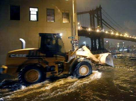 A construction vehicle drives through the flooded streets of the DUMBO neighborhood of Brooklyn, as superstorm Sandy makes its way north. Reuters photo Superstorm Sandy strikes US