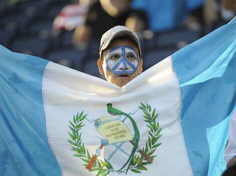 A Guatemalan fan shows support for his team before Guatemala