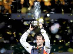 Novak Djokovic holds up the trophy after beating Andy Murray in final of the Shanghai Masters tennis tournament in Shanghai. AFP Photo Masters of Shanghai