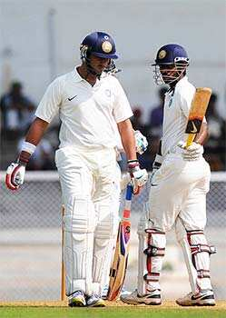 India A cricketer Yuvraj Singh (L) walks as teammate Abhinav Mukund raises his bat after scoring half a century during the first day of a three-day practice match between India A and England at the Cricket Club of India (CCI) grounds in Mumbai. AFP Photo/Pal Pillai Warming up: India A vs England