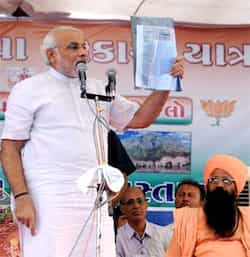 Gujarat chief minister Narendra Modi addresses a public meeting in Junagadh district. PTI Crowd puller Modi