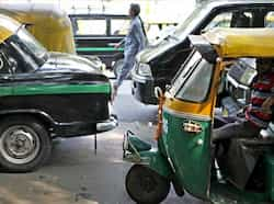 Autorickshaw and taxi unions protest at Jantar Mantar demading a hike in fares and high prices of GPS devices that have to be installed in the vehicles in New Delhi. (Photo by M Zhazo/Hindustan Times) Oct 15: Day in pics